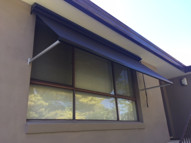 Pivot arm awning.